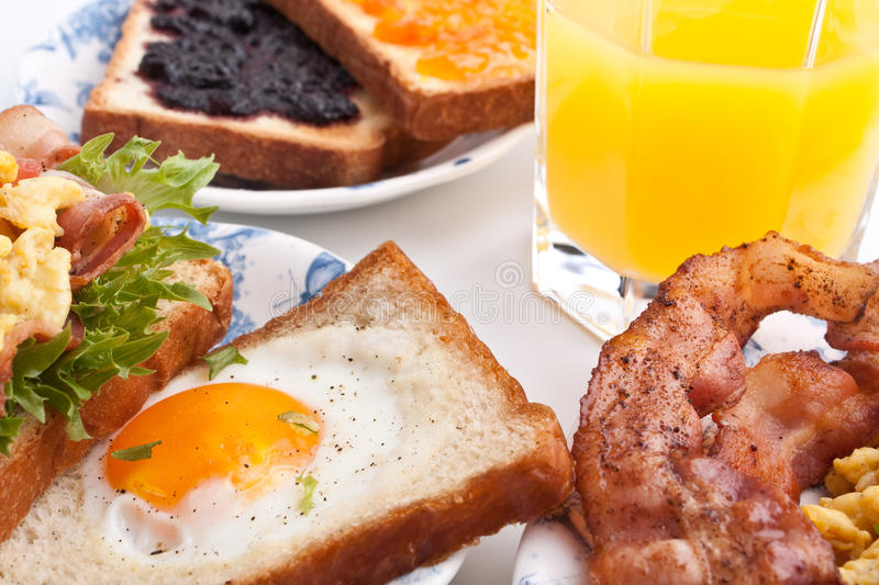 Traditional breakfast with juice, eggs and bacon royalty free stock images