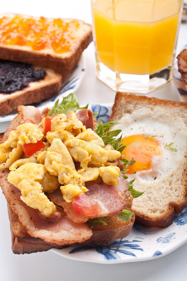 Traditional breakfast with juice, eggs and bacon royalty free stock image