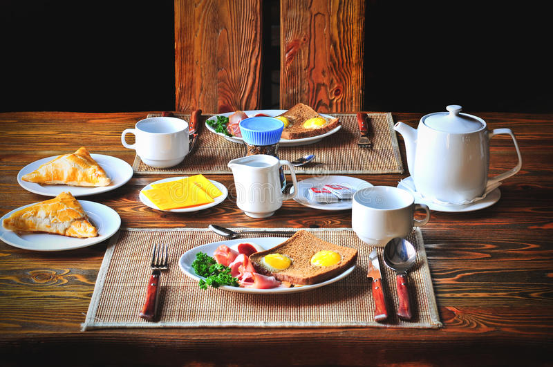 Download Traditional Breakfast Set For Two Persons On The Wooden Table. Stock Image - Image & Traditional Breakfast Set For Two Persons On The Wooden Table. Stock ...