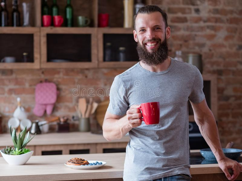 Traditional breakfast tea kitchen man red mug royalty free stock image