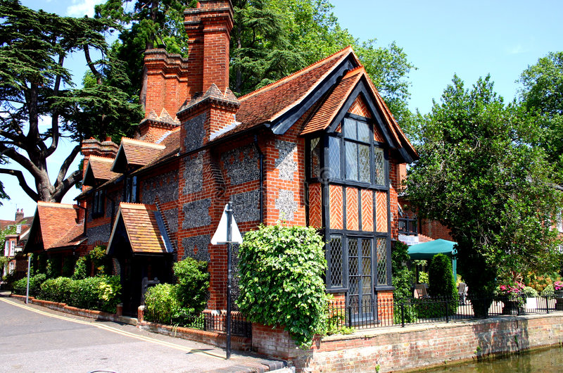 Traditional brick and flint cottage royalty free stock photos