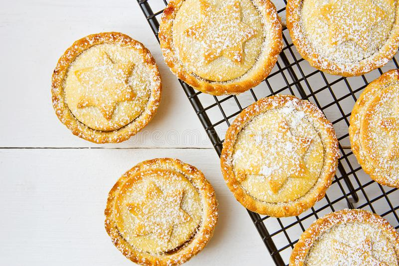 Traditional British Christmas Pastry Dessert Home Baked Mince Pies with Apple Raisins Nuts Filling on Cooling Rack stock images