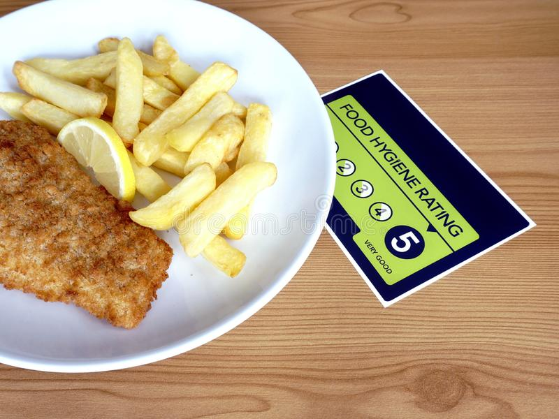 Traditional British fish and chips and VERY GOOD food hygiene rating. Food Hygiene Rating 5. Traditional British fish and chips and VERY GOOD food hygiene rating royalty free stock photo