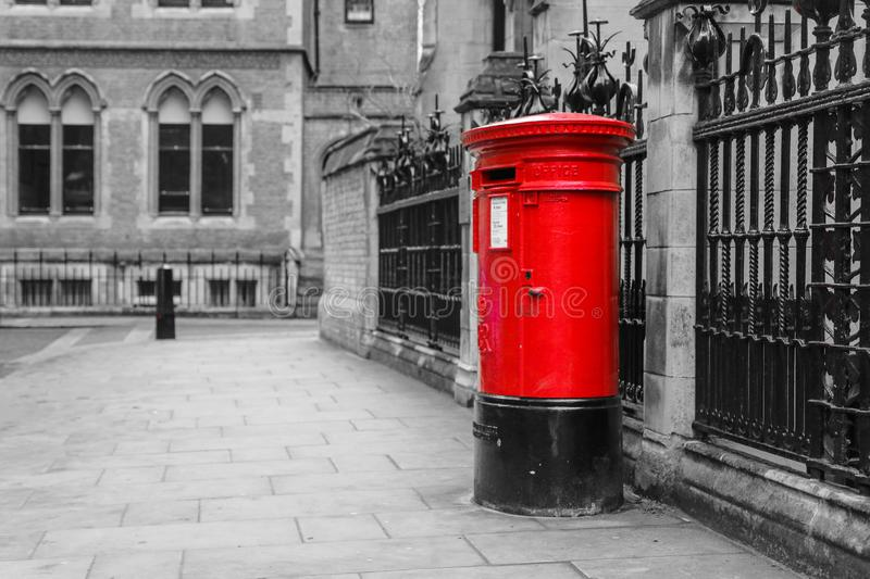 The traditional British red post box in London royalty free stock images