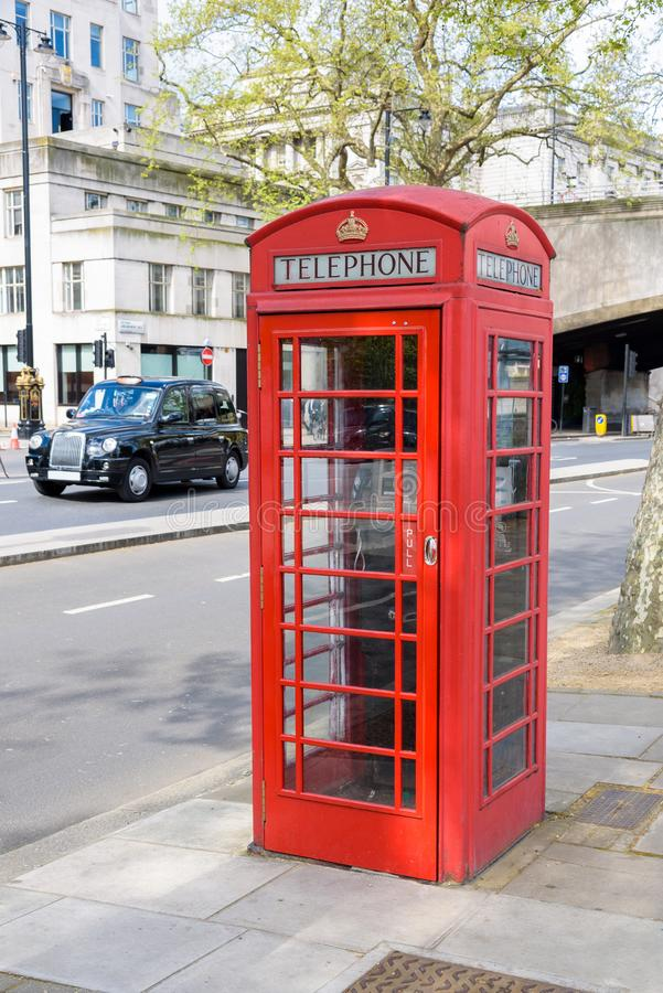 Traditional british red telephone booth. In London, UK stock images