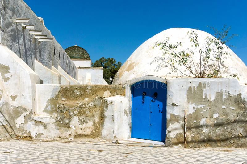 Traditional building in Houmt El Souk in Djerba, Tunisia. Entrance with blue traditional doors in Houmt El Souk, Djerba, Tunisia stock photography