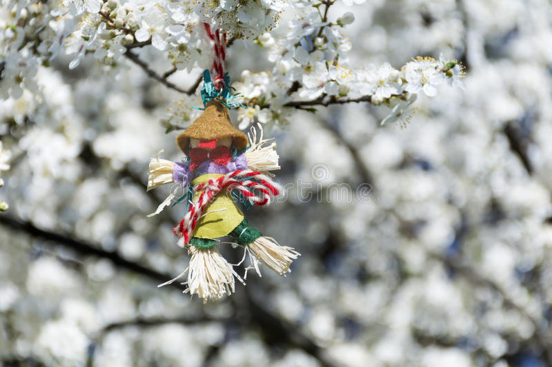 Traditional bulgarian martenitsa on a blooming spring tree royalty free stock image