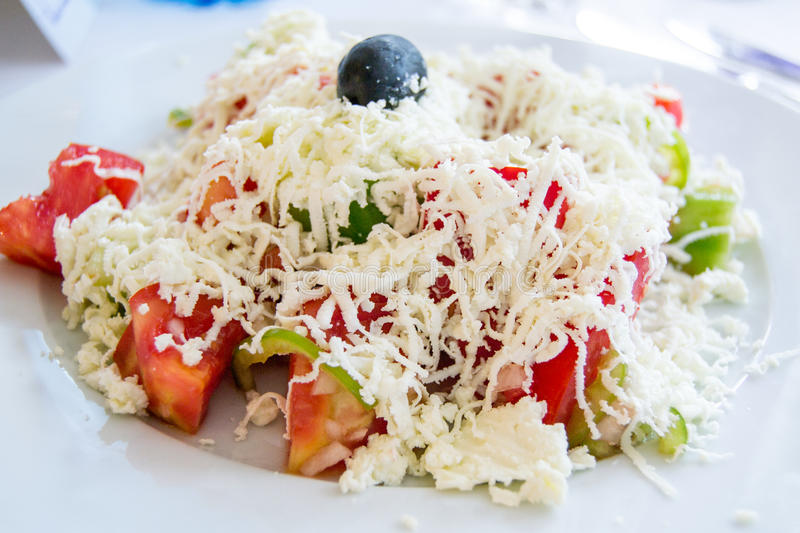 Traditional Bulgarian salad with tomatoes, cucumbers, cheese and olive stock images