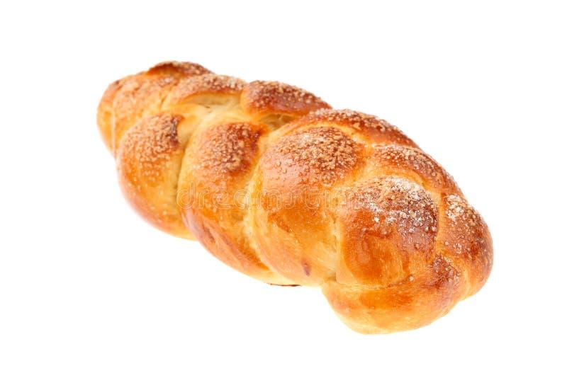Traditional Bulgarian sweet leavened bread Kozunak, braided and sprinkled with sugar, isolated on white. In Bulgaria Kozunak is stock image