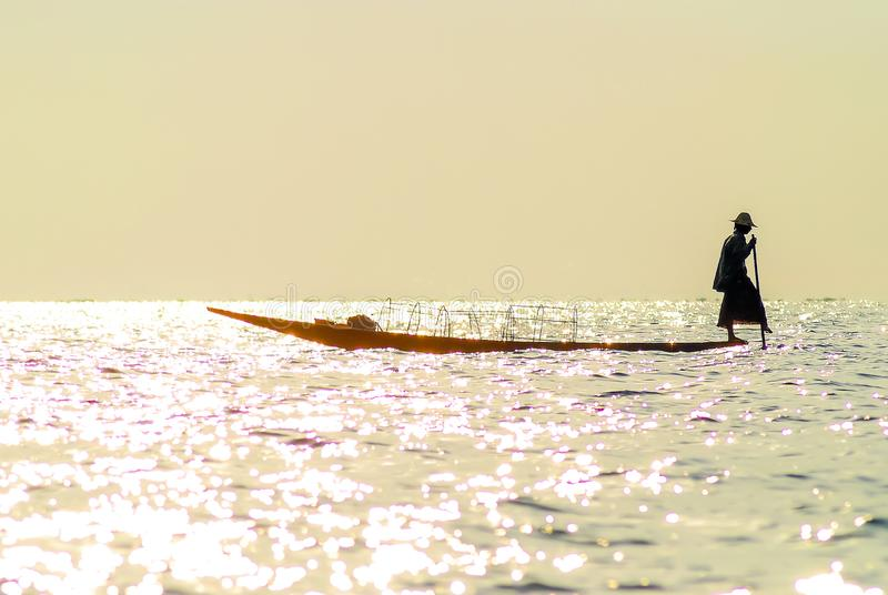 Traditional Burmese fisherman at Inle lake, Myanmar famous for their distinctive one legged rowing style royalty free stock images
