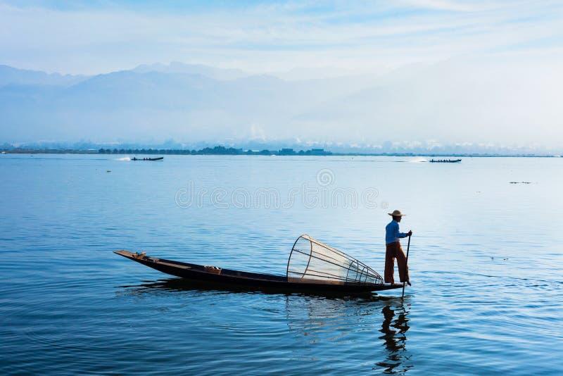 Traditional Burmese fisherman at Inle lake, Myanmar. Myanmar travel attraction landmark - Traditional Burmese fisherman at Inle lake, Myanmar famous for their stock photos