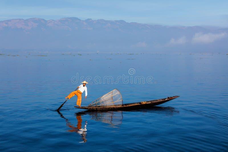 Traditional Burmese fisherman at Inle lake, Myanmar. Myanmar travel attraction landmark - Traditional Burmese fisherman at Inle lake, Myanmar famous for their stock photography