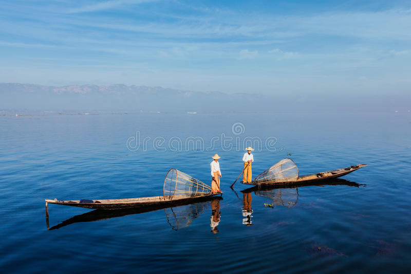 Traditional Burmese fisherman at Inle lake, Myanmar. Myanmar travel attraction landmark - Traditional Burmese fishermen with fishing net at Inle lake in Myanmar stock photography