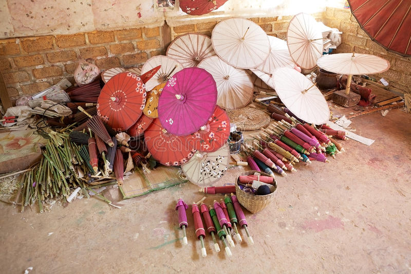 Traditional Burmese parasol. At the Pindaya workshop, Myanmar or Burma. In Burmese tradition the parasol is a symbol of high honor in Myanmar monastic life stock photography
