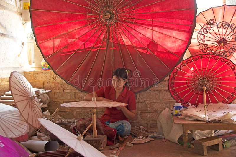 Traditional Burmese parasol. Burmese woman is making the traditional burmese parasols at the Pindaya workshop, Myanmar or Burma. In Burmese tradition the parasol royalty free stock photos