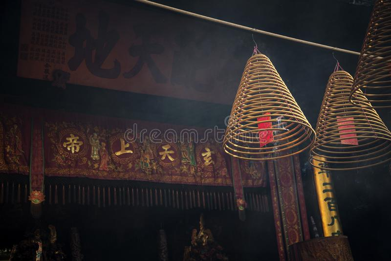 Traditional burning incense coils inside chinese a-ma temple in macau royalty free stock photo