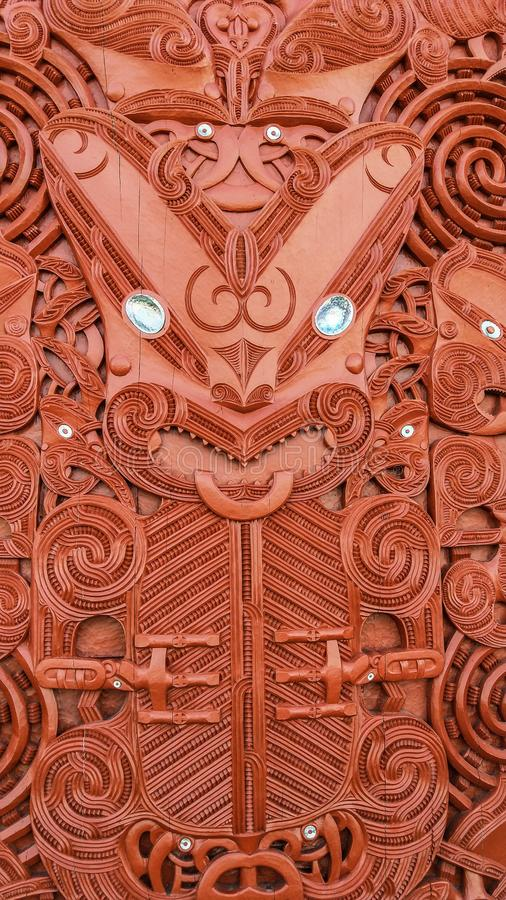 Traditional Carved Maori Board. Red wood stock photos