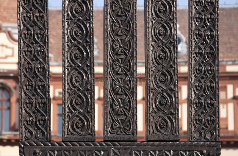 Traditional carved wood - RAW format. Romanian traditional carved wood on building background stock photo