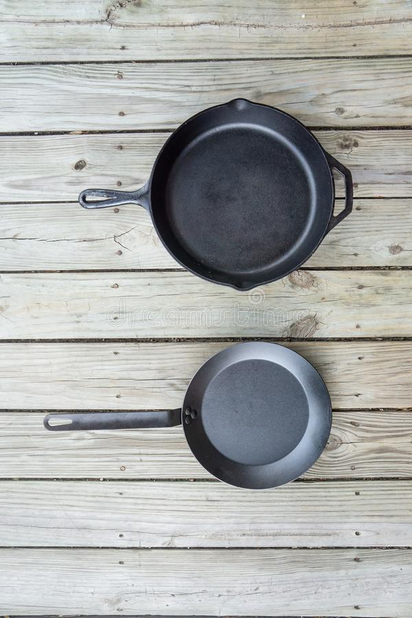 Traditional cast iron vs carbon steel versus teflon cooking options - copy space royalty free stock photography