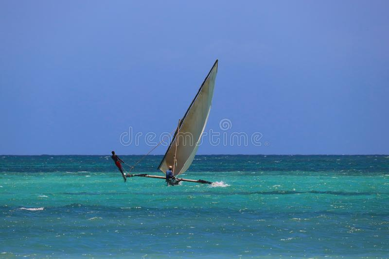Traditional catamaran Dhow with fishermen stock images