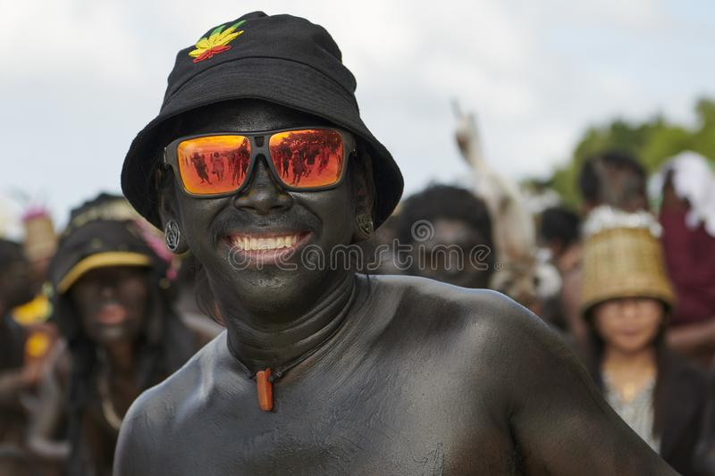 Participant of the Ati-Atihan parade on Boracay wearing sunglasses. The traditional catholic Ati-Atihan Festival parade is held in honor of the Santo Niño stock images