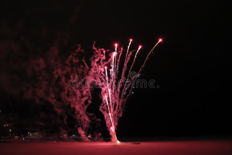 Traditional celebration with New Year`s fireworks in Luleå royalty free stock images