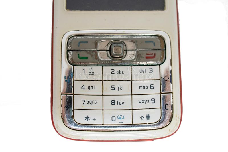 Traditional mobile phone in second generation with keyboard button and mini black and white monitor by white isolate die cut backg. Traditional cellphone during stock image