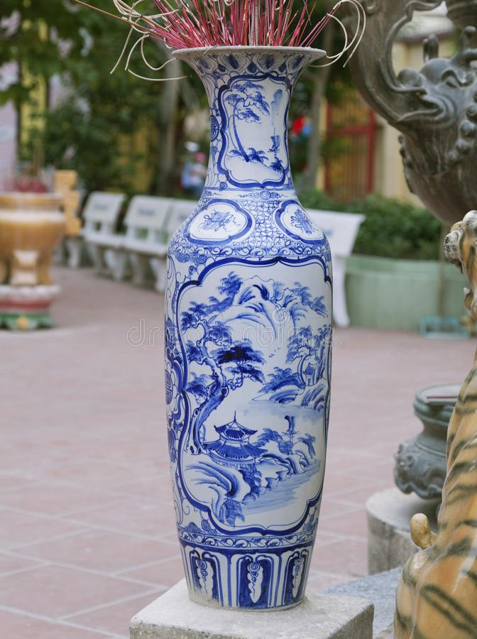 Traditional ceramic incense burner. Traditional Chinese blue-and-white ceramic incense burner at the entrance of a temple royalty free stock photos