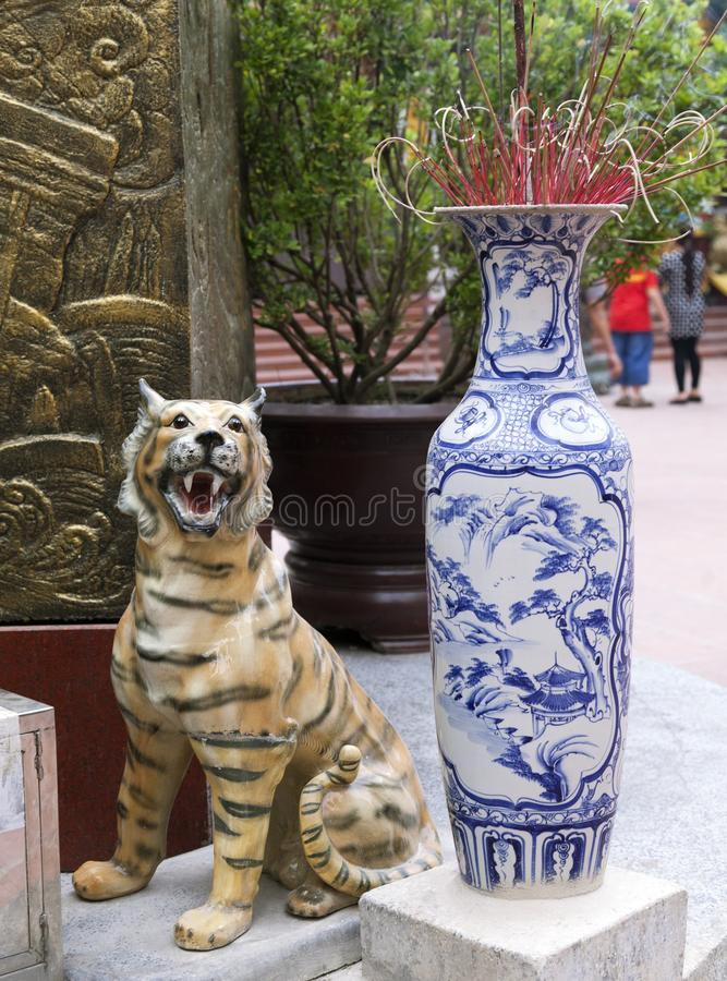 Traditional ceramic incense burner. Traditional Chinese blue-and-white ceramic incense burner at the entrance of a temple royalty free stock photography