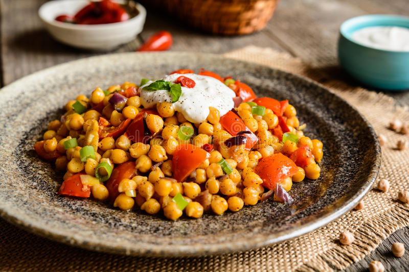 Traditional Channa Masala – spicy chick peas. Traditional Indian Channa Masala – spicy chick peas with tomato, pepper and curry royalty free stock photography
