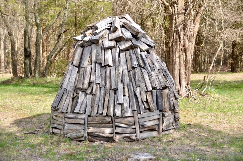 Charcoal Kiln. A traditional charcoal kiln made of piled logs royalty free stock photos