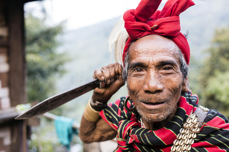 Traditional Chin tribe man. MINDAT, MYANMAR - DECEMBER 7: Chin traditional dressed man poses for a photo on December 7, 2015 Mindat, Myanmar. Chin people, also stock image