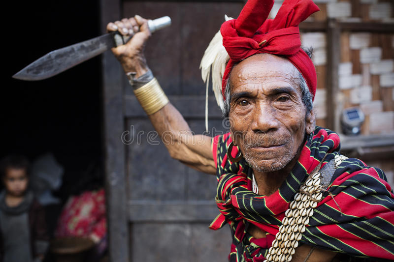 Traditional Chin tribe man. MINDAT, MYANMAR - DECEMBER 7: Chin traditional dressed man poses for a photo on December 7, 2015 Mindat, Myanmar. Chin people, also royalty free stock photo
