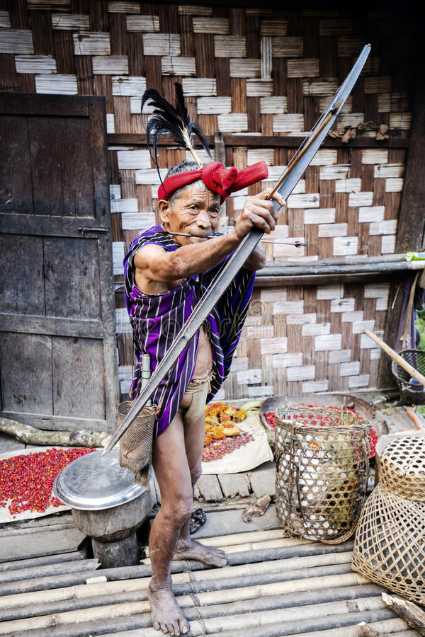 Traditional Chin tribe man. MINDAT, MYANMAR - DECEMBER 7: Chin traditional dressed man poses for a photo on December 7, 2015 Mindat, Myanmar. Chin people, also stock photo