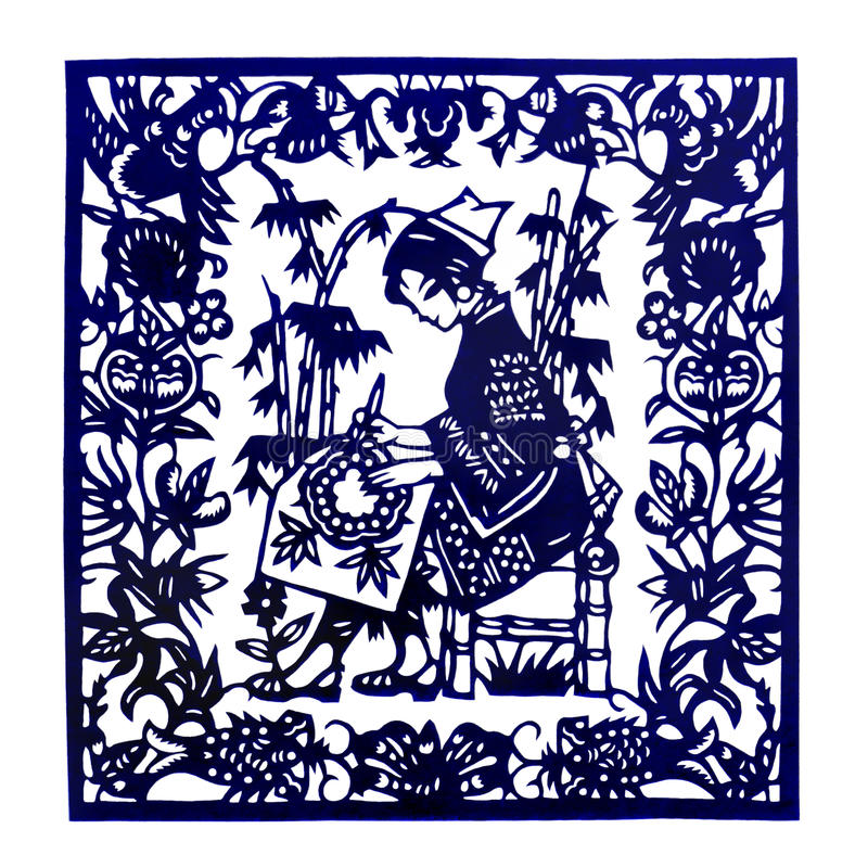 Traditional China paper cut. A photograph showing the beautiful and intricate paper ethnic art of China, paper cutting portraying scenes of daily life of the royalty free stock image