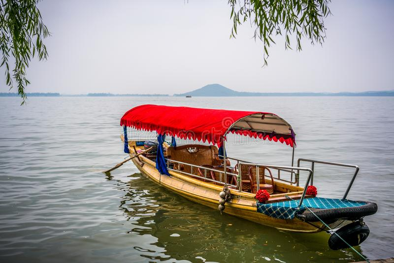 Traditional chinese boat close-up view in Wuhan city Donghu east lake and Moshan hill in China royalty free stock photo