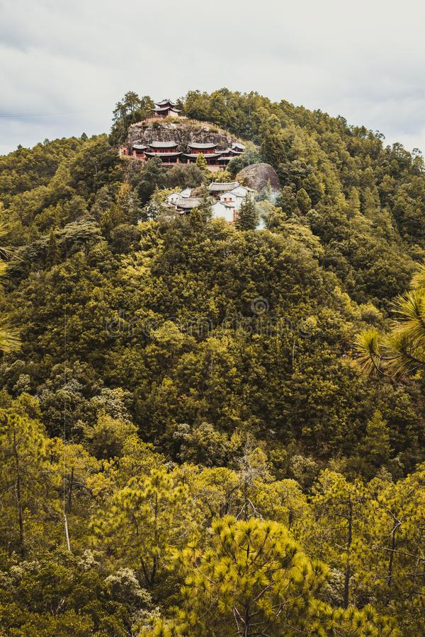 Traditional Chinese Buddhist temple on top of a mountain. stock photography