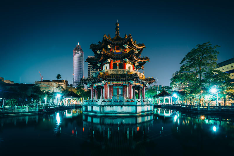 Traditional Chinese building and pond at night, at 2/28 Peace Park stock photography