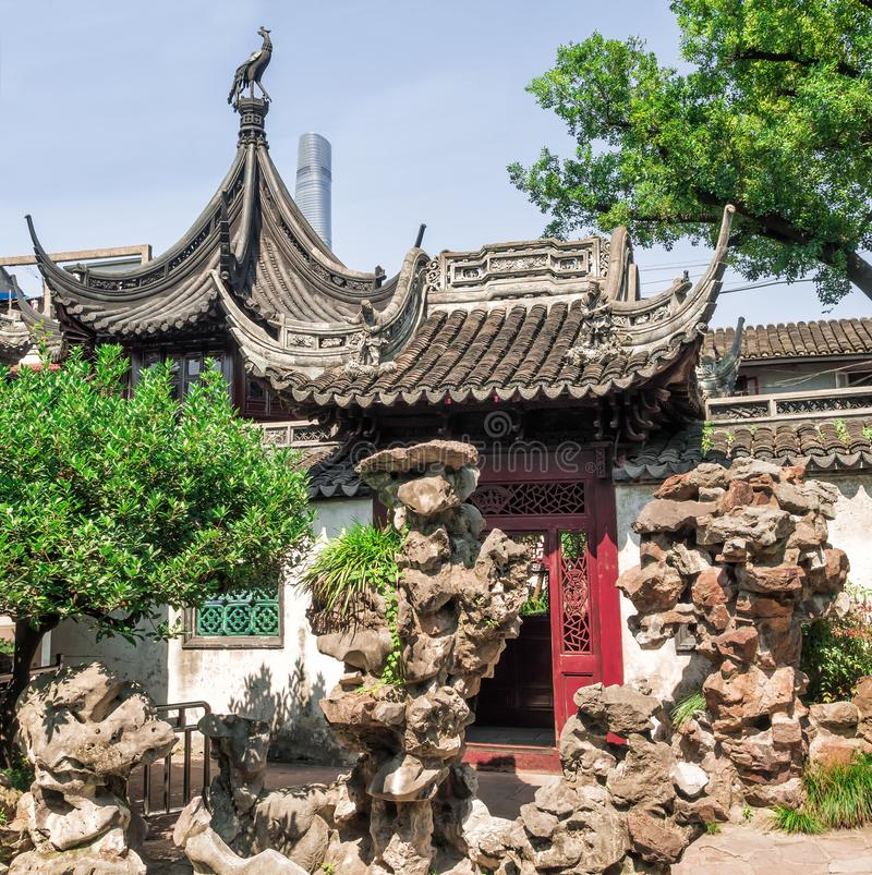 Traditional chinese building and rocks at Yu Gardens, Shanghai, China.  stock photos