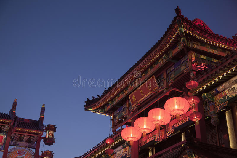 Traditional Chinese buildings illuminated at night in Beijing, China stock photos