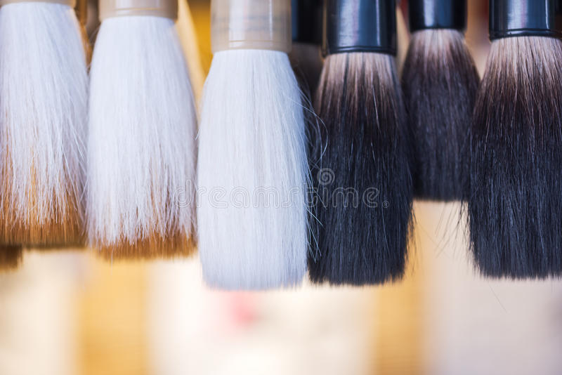 Traditional Chinese calligraphy brushes hanging in a shop. China royalty free stock images