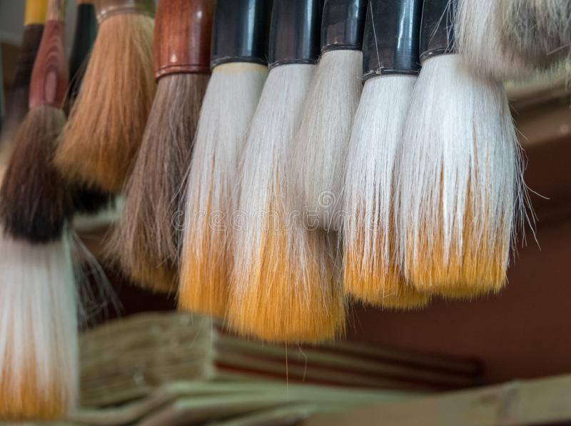 Traditional chinese calligraphy brushes in store. Display of traditional chinese calligraphy brushes hanging in store in Tianjin royalty free stock images