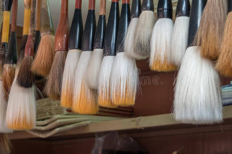 Traditional chinese calligraphy brushes in store. Display of traditional chinese calligraphy brushes hanging in store in Tianjin stock photography