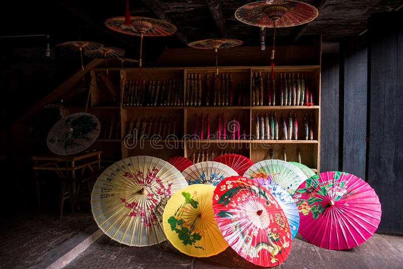 Traditional chinese colour oiled paper umbrella. There are many colours oiled paper umbrella in a umbrella shop which at the ancient Tanghe town of Jiangjin royalty free stock photography