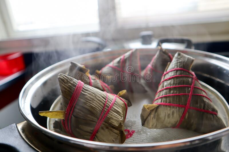 Traditional chinese dessert made with white rice and bamboo leafs stock photo