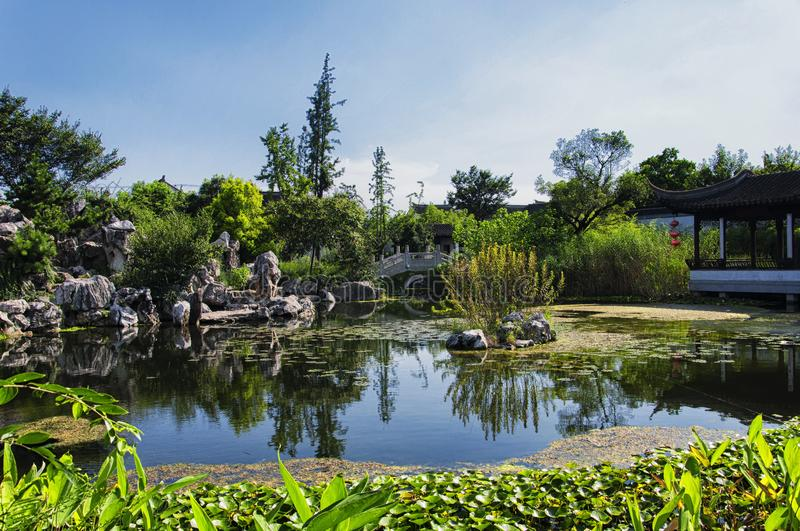 Traditional Chinese garden Luzhi town. A traditional Chinese garden located within Luzhi town in wuzhong china on a sunny blue sky day stock photography