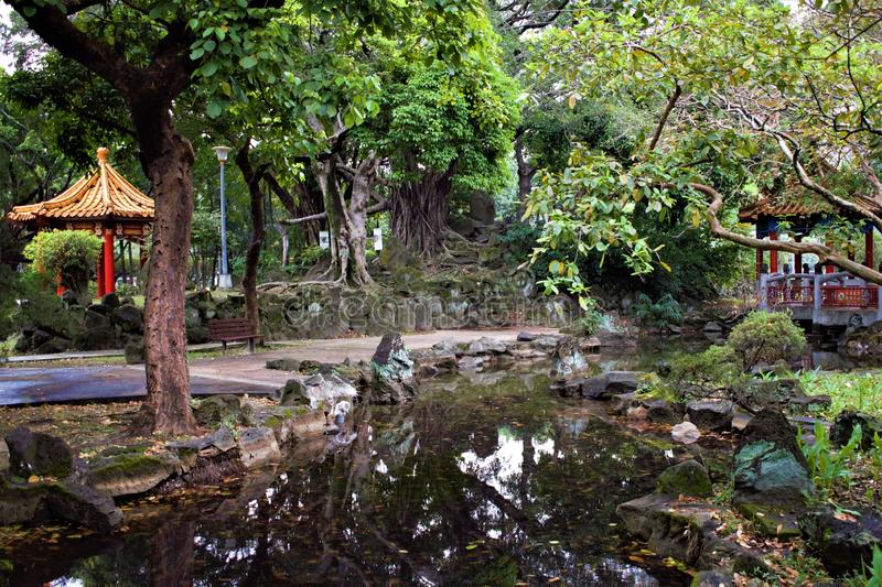 Traditional chinese garden with two pavilions in Taipei, Taiwan stock photography