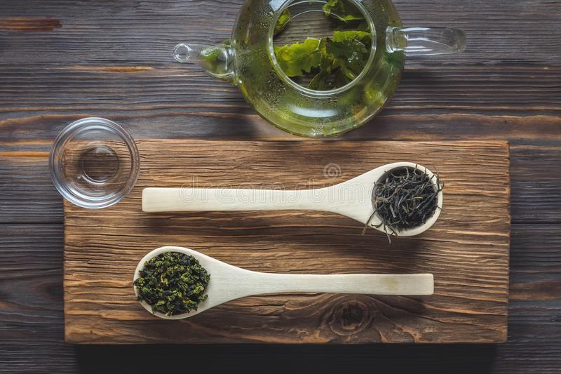 Traditional Chinese green tea of different fermentation and rice. Traditional Chinese green tea different fermentation wooden culinary spoons teapot with fresh stock images
