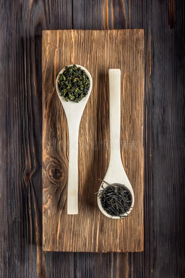 Traditional Chinese green tea of different fermentation and rice. Traditional Chinese green tea different fermentation wooden culinary spoons with fresh brewed stock photography