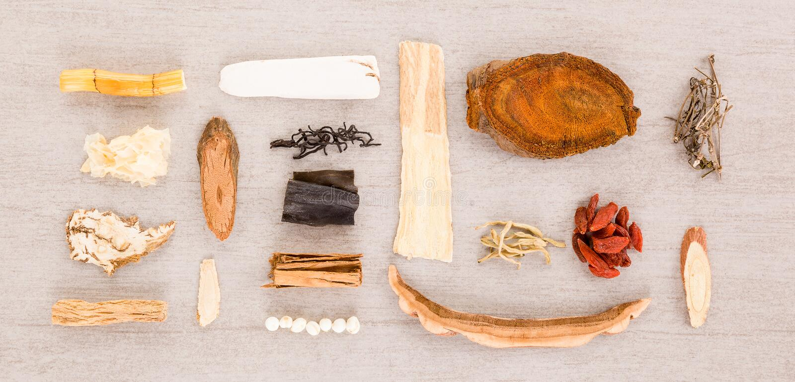 Traditional chinese herb ingredients used in alternative herbal medicine. Traditional chinese medicine knolled together from above stock photos